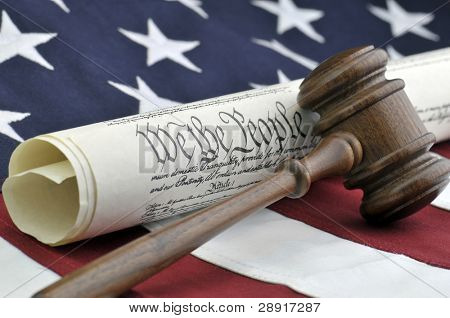 We The People - Constitution document, gavel, and American flag
