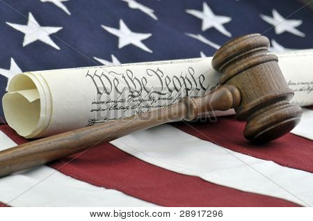 American symbols of freedom - Constitution document, gavel, and American flag