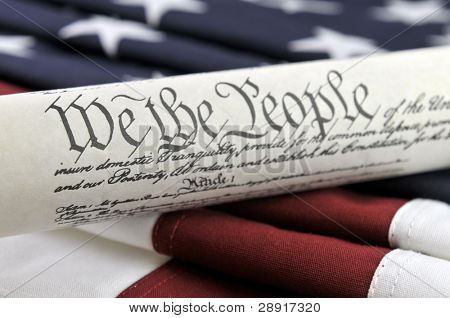 We The People - US Constitution and American flag background.