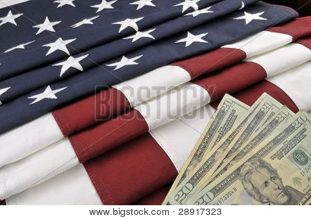 Government and Money - US currency and American flag
