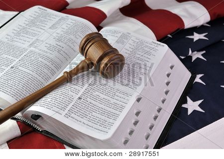 Wooden gavel, Bible, and flag - American Judicial system based upon Christian principles