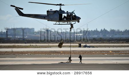 MIRAMAR, CA - OCTOBER 3: Marine Corps soldiers repel from a Huey UH-1 helicopter during an airshow on October 3rd, 2009 in Miramar, California.