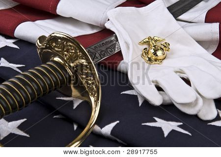 Symbols of the Marine Corps - insignia,  sabre, white gloves, and flag