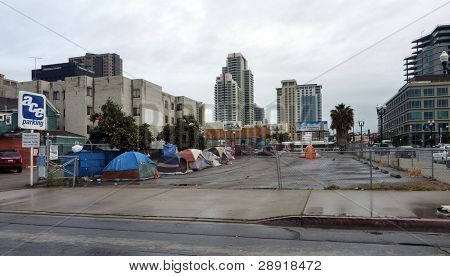 SAN DIEGO, CALIFORNIA - APRIL 4: Several tents in a public parking lot are home to a few of the over 8,000 homeless people on the streets on April 5, 2010 in San Diego, California.