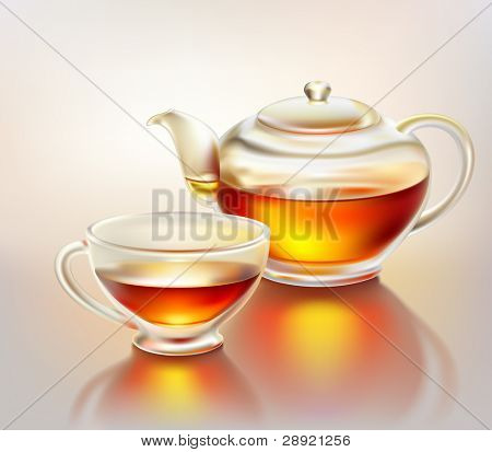 Glass teapot and cup with tea in morning sunlight