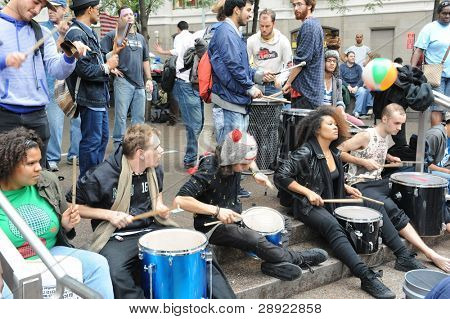 NEW YORK - OCTOBER 14: Unidentified protesters participate at an 'Occupy Wall Street' camp in Zuccotti Park Downtown Manhattan on October 14, 2011 in New York.