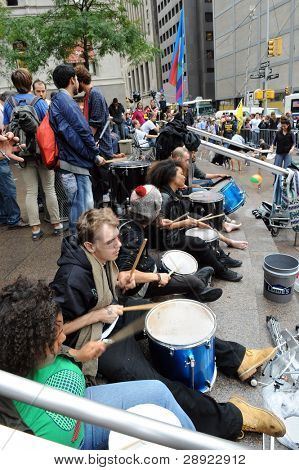 MANHATTAN, NY - SEPT. 18: People playing drums in Zuccotti Park as part of the 'Occupy New York' Protests on September 18, 2011 in Manhattan, NY.