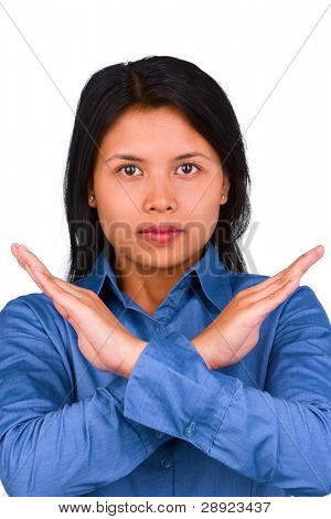 A young woman's gesture to express her objection by crosing her hand in front of her.