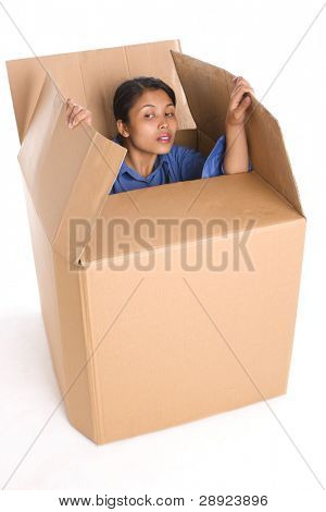 A young woman is curiously looking outside the box.