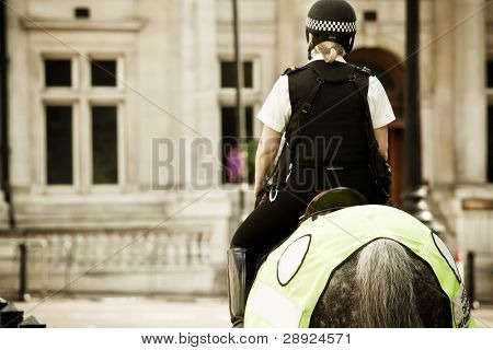 Young mounted policewoman patrolling in London