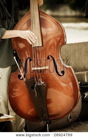 Street artist performing double bass