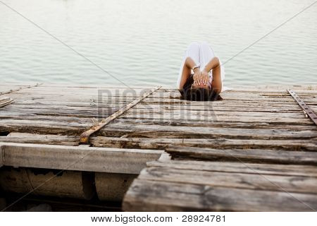 Young desperate woman over wooden surface