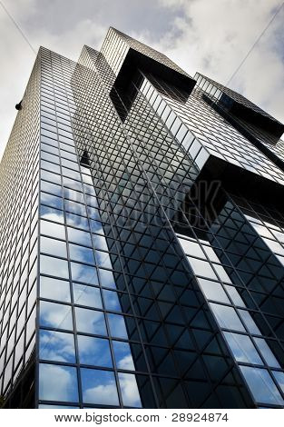 Office building under dramatic cloudscape