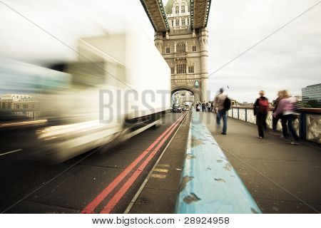 Blurred traffic and pedestrians over the Tower Bridge at London