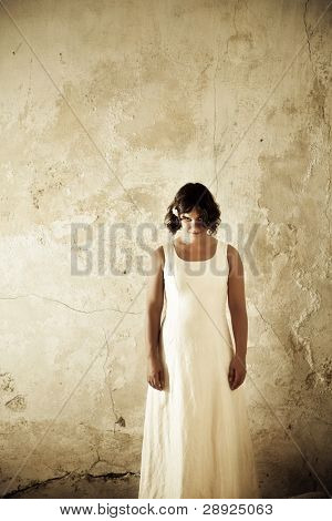 White dressed creepy young woman portrait