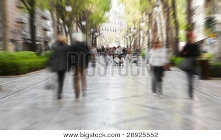 Blurred pedestrian taking a walk in urban background.