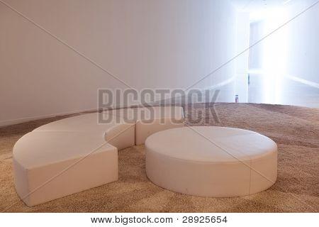 Poufs on carpet in an empty room.