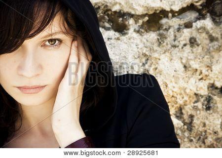 Young woman staring at camera, copyspace
