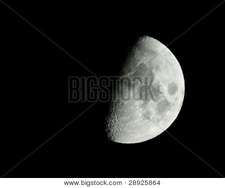 Half moon isolated on the blackness of the space
