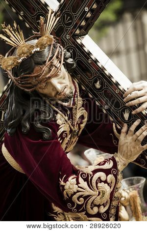 Christ figurine on the streets in April catholic celebration.