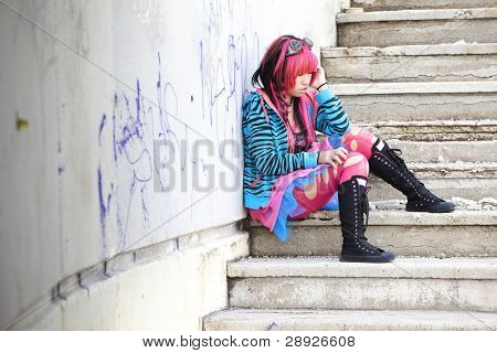 Young asian sad girl with cosplay looking.