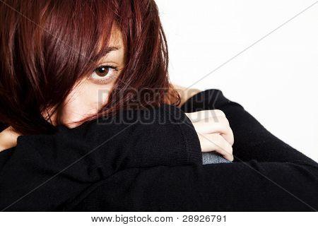 Young girl hidden under her hair.