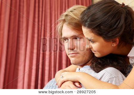 A couple taken close up in living room spending time together