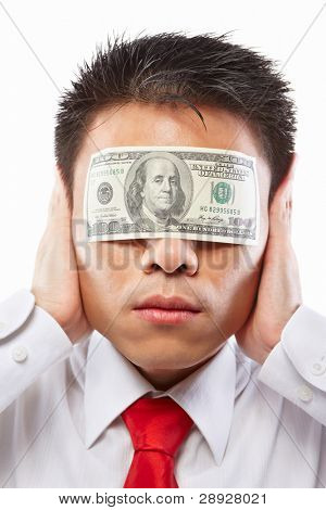 Chinese young man with his eyes sealed by a hundred dollar bills, for bribe concept