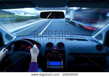 Blurred overtaking from inside vehicle, unrecognizable driver