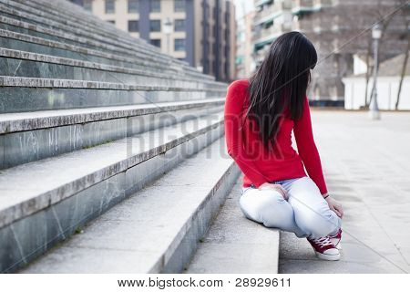 Anonymous teen in urban background