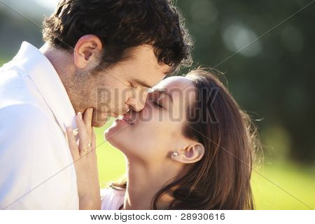 Young couple showing their love outdoors.