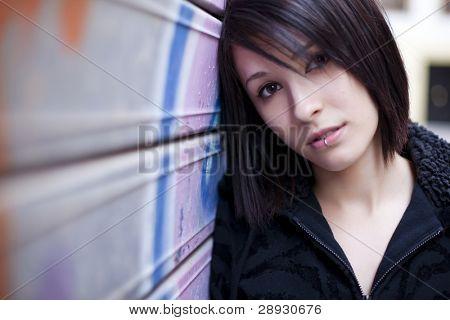 Young beautiful girl posing on urban background.