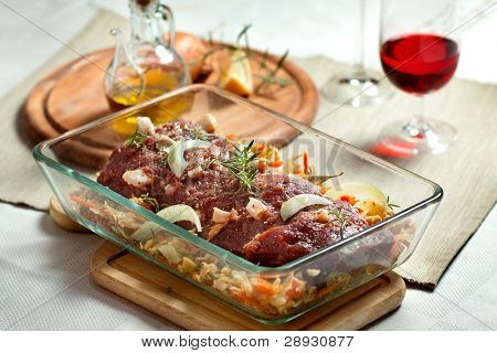 fresh raw deer meat in a glass bowl