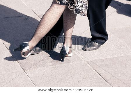 Street dancers performing tango dance. Aged tone. Copy space.