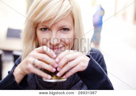 Portrait of young beautiful happy woman with ice tea