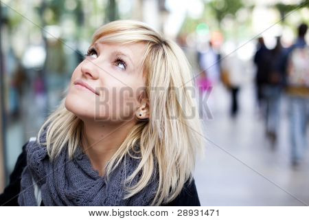 Young beautiful urban girl looking at what surrounds her.