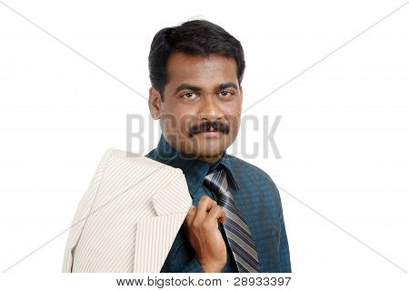 indian businessman posing to the camera.