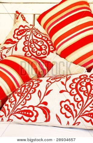 a Collection of bright colored pillows