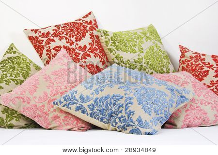 Combination of different colored and patterned pillows