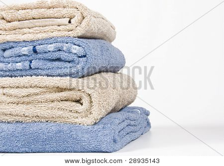 Stone and blue colored towels stacked up