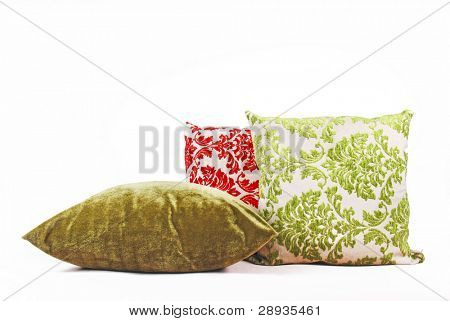 Green and red cushions against a white background - not isolated