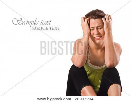 a Very discouraged unhappy young woman on a white background with space for text
