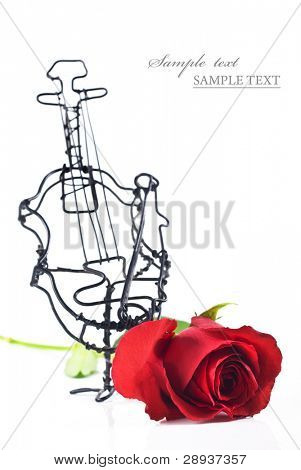 a Violin made of wire with a red rose on white background with space for text