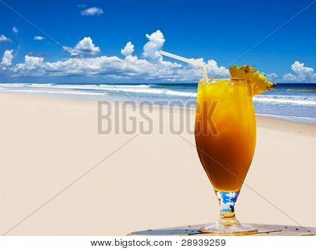 A fresh fruit cocktail on a tropical island beach