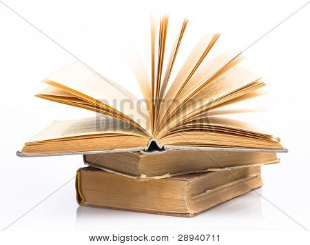 Old books piled together over white background