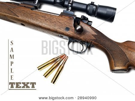 Close up of a rifle and bullets on a white background with space for text