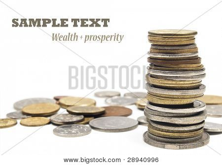 Money - coins stacked up on a white background with space for text