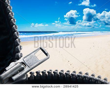 a Zipper opening up to show a tropical island beach