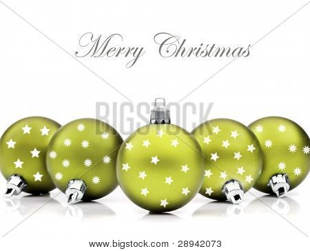 Colorful green christmas decoration baubles on white with space for text