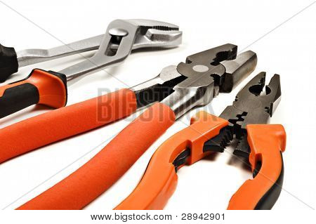 Three different pliers on a white background with space for text